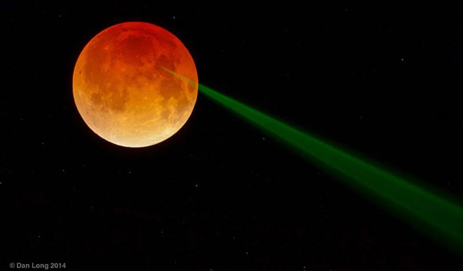 green laser light hitting moon, photo by Dan Long