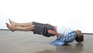 Tony Matelli's lifelike sculpture of a supine man appears to float a foot above ground