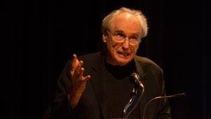 Frank Bidart speaking at podium