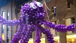 giant purple balloon octopus suspended from Science Center ceiling