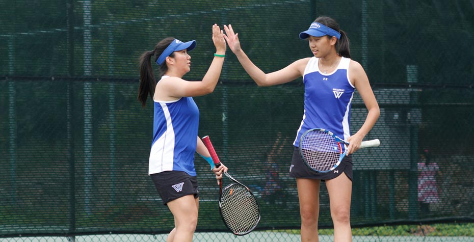 Carina Chen and Sojung Lee exchange high five on tennis court