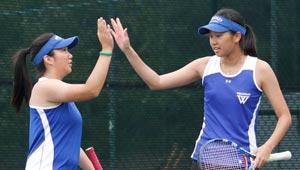 Carina Chen and Sojung Lee high five on tennis court