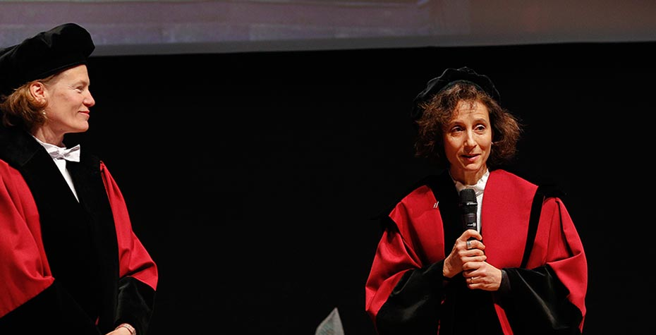 Peggy Levitt at microphone upon receiving honorary degree