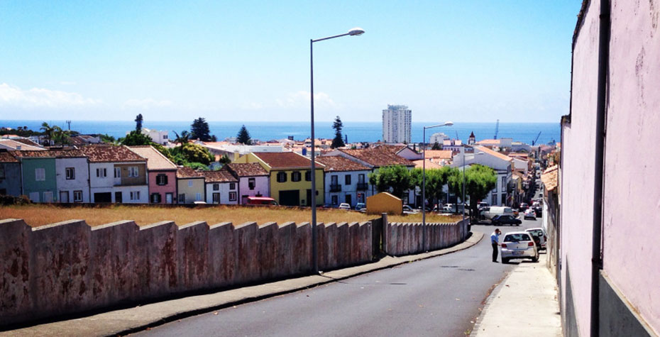 street scene with ocean in distance