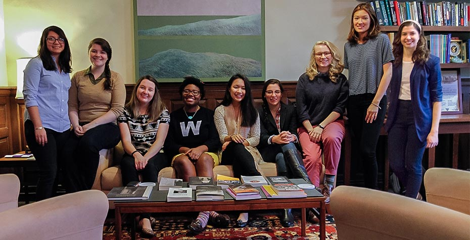 9 Daniels Fellows sit together in Provost's office