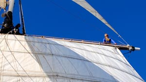 Sophia Sokolowski high in the rigging of sailboat