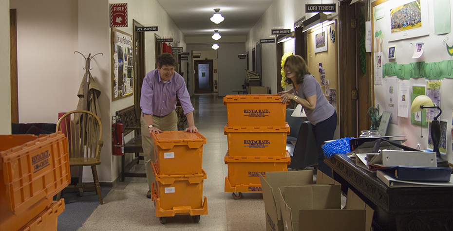 John O'Keefe and Lori Tenser laugh while moving boxes in Green Hall