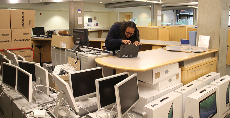 Kanda Faye '15 working on refurbishing retired computers at Wellesley