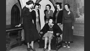 1937 photo of change of new college government pres trying on shoes of old