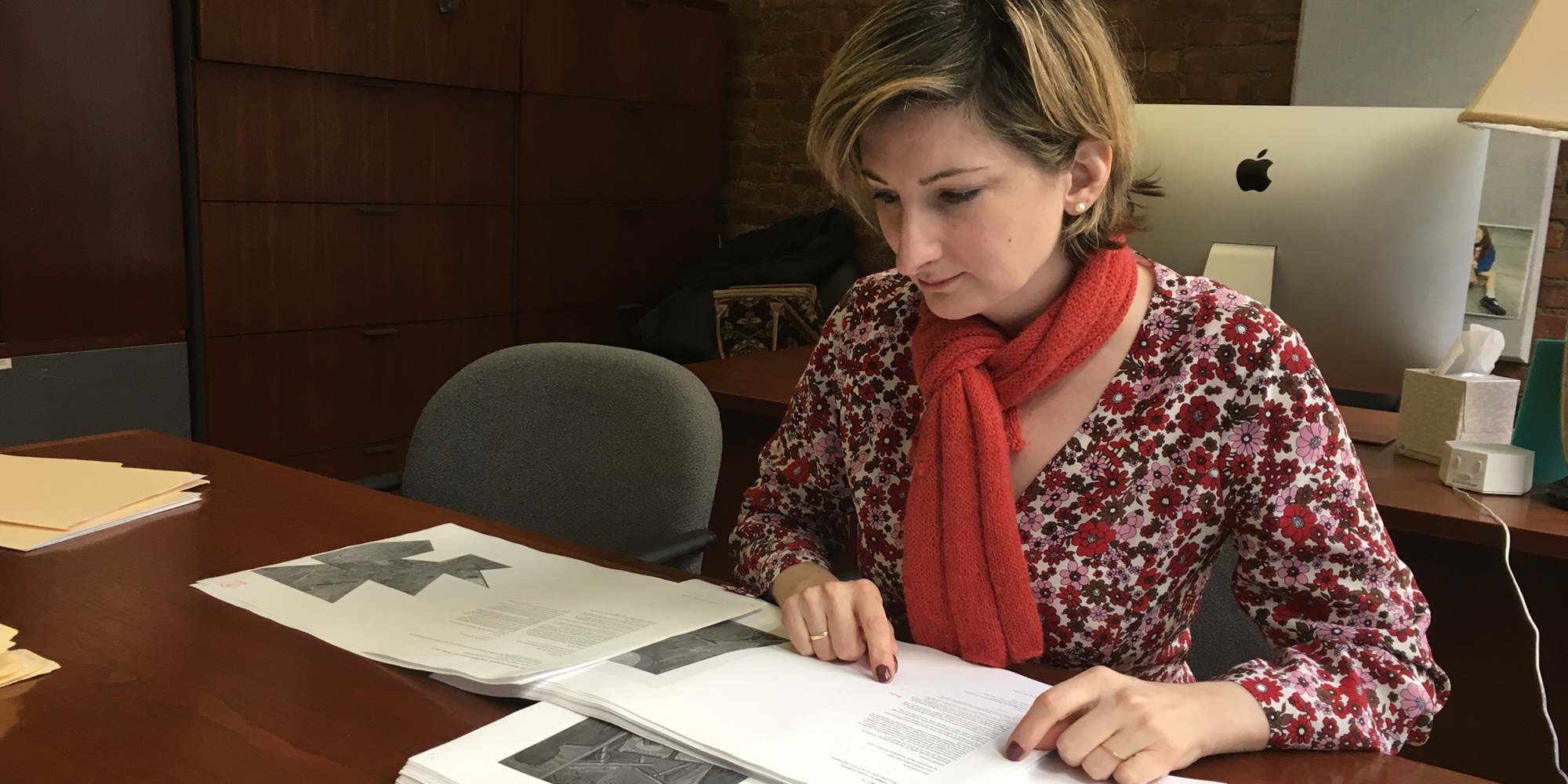 Elizabeth Gorayeb '97 examines papers in her office.
