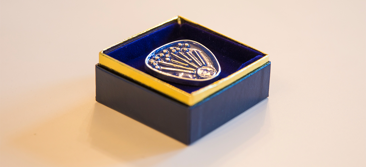Albright Institute Story Told Through Artisan Designed Pin