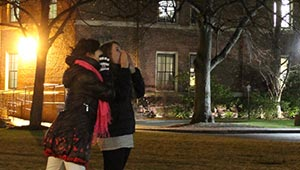 two students enjoying a good scream outside a res hall