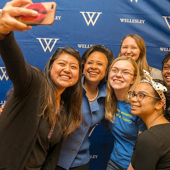 students take a selfie with President Johnson