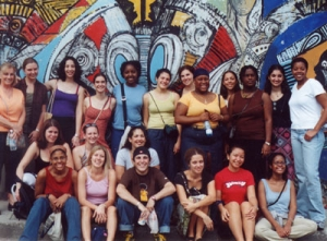 wintersession students in front of Cuban mural