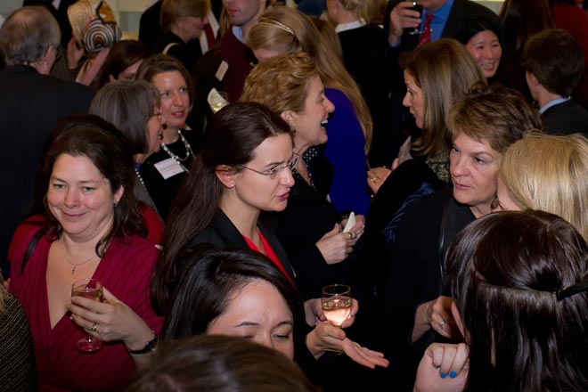 crowd of alumnae at reception