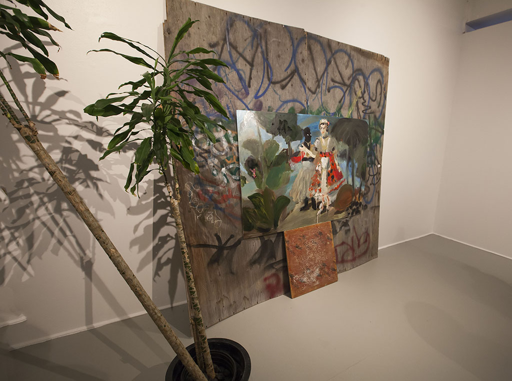 painting by Alida Cervantes with large potted plant installation