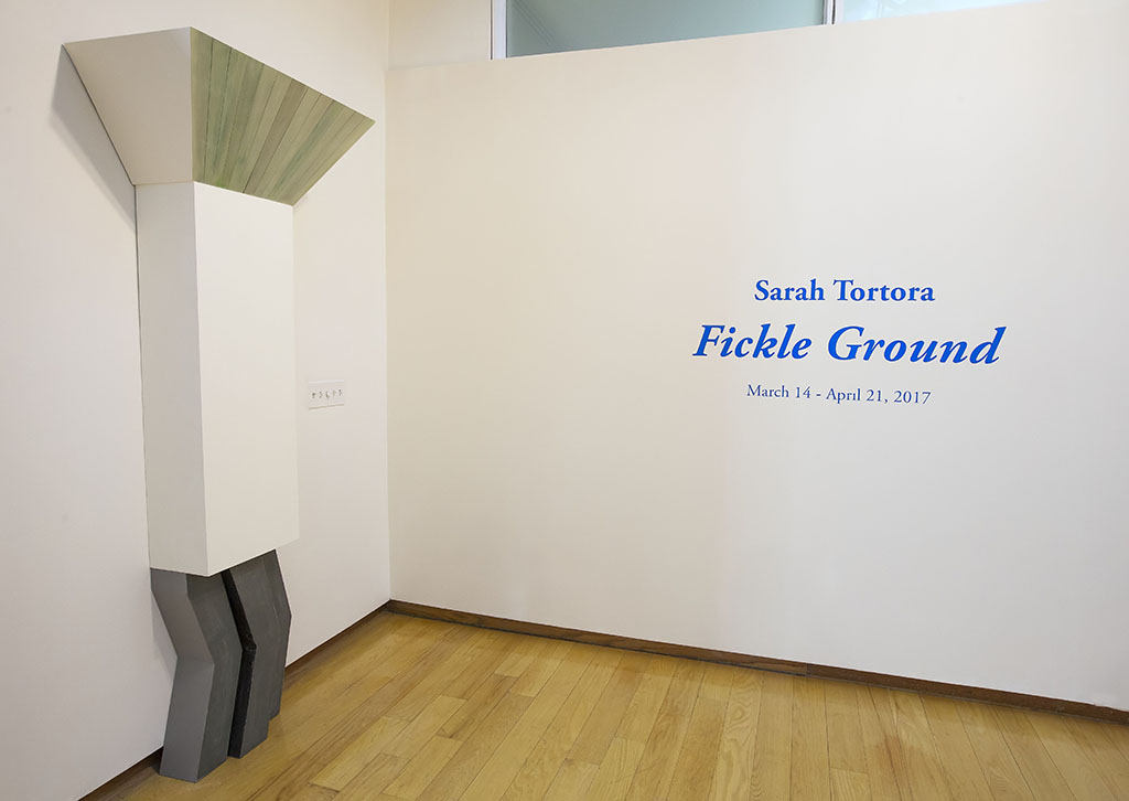 Sculpture by Sarah Tortora with exhibition wall text