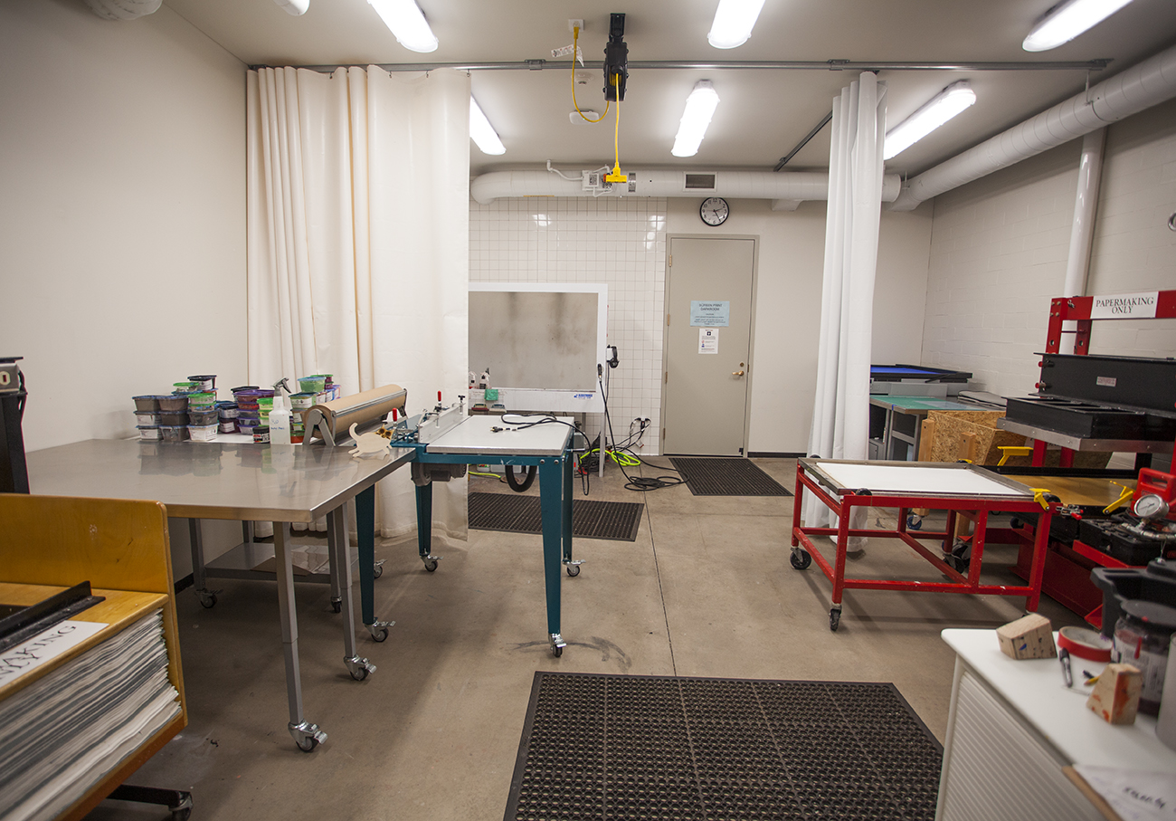 papermaking and screenprinting room with white curtain partially dividing the space
