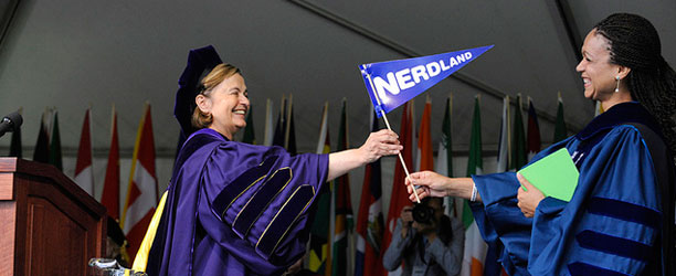 "President Bottomly presents Melissa Harris-Perry with a pennant reading ""Nerdland"""