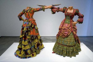 Yinka Shonibare, How to Blow up Two Heads (Ladies), 2006. Two fiberglass mannequins, two prop guns, Dutch wax printed cotton textile, shoes, leather riding boots, plinth. Museum purchase with funds provided by Wellesley College Friends of Art, 2007.124.1-.2
