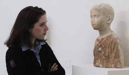 Mairead Blue, Class of 2005, studying a Roman Bust of a Child, 200-300 A.D. Marble, 17 1/2 x 13 x 7 in. Gift of Mrs. William H. Hill (Caroline Rogers, Class of 1900), 1924.22