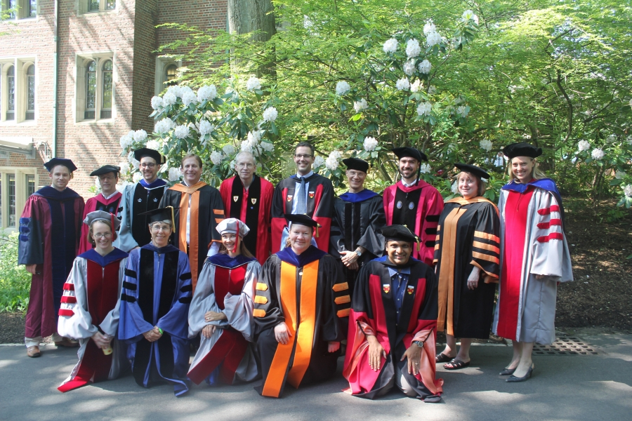 Economic professors in commencement regalia