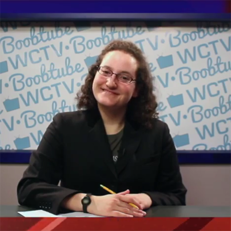 Student standing in front of WCTV's background
