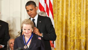 President Obama puts medal of freedom around Albright's neck