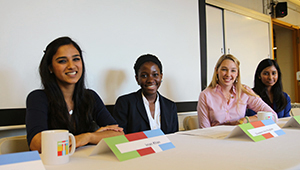 four students at table for panel talk