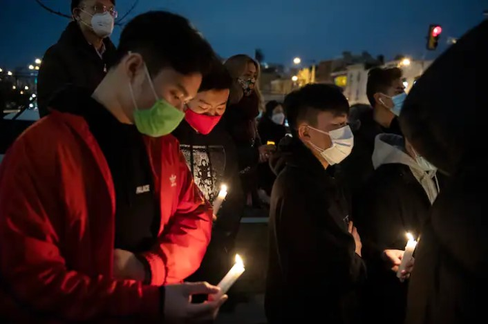 Community members gather for a vigil to mourn and confront the rising violence against Asian Americans at the 10th Street Plaza