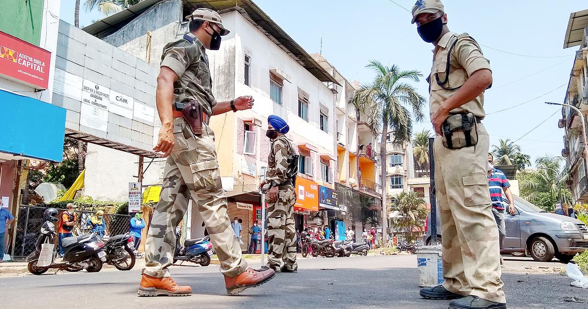 Central Reserve Police Force personnel patrol the streets in Goa, India.