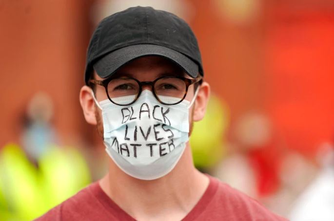 Josh Hillman wears a mask to an interfaith procession in Pittsfield, Mass., on June 14