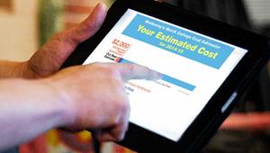 Hands shown using Wellesley's Cost Estimator Tool on an iPad