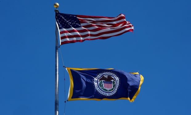 US flag and Federal Reserve flag