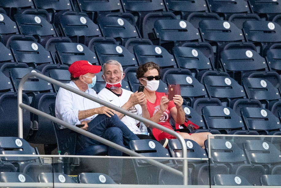 Anthony S. Fauci, director of the National Institute of Allergy and Infectious Diseases, center, at Nationals Park.