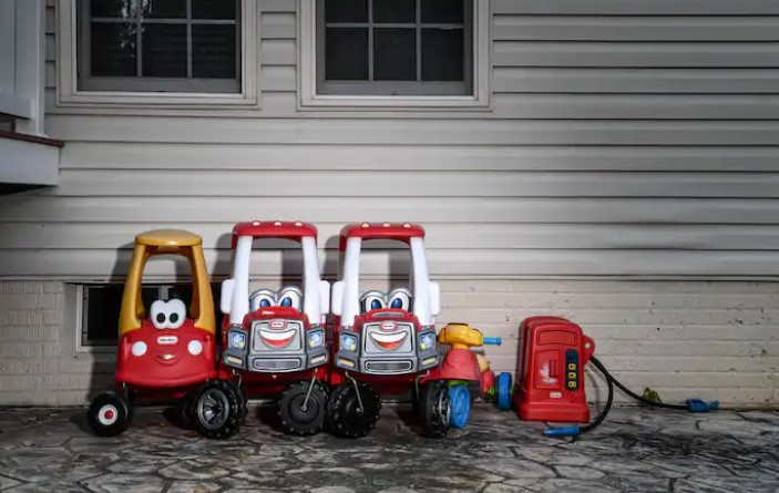 Toy cars outside a home