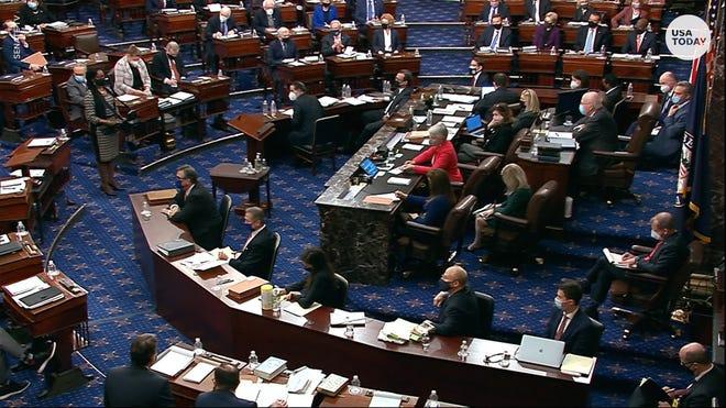 Senators during impeachment trial