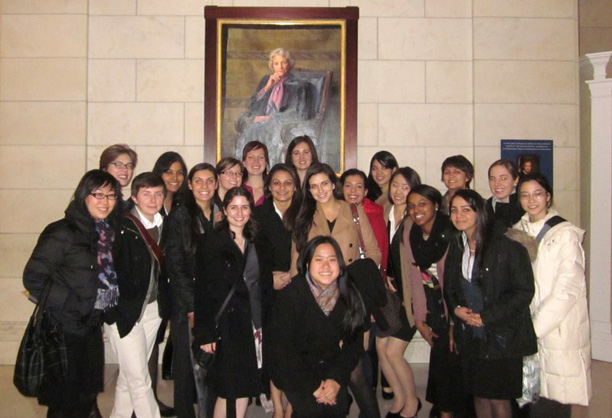 Wellesley in Washington students pose in front of Sandra Day O'Connor's portrait