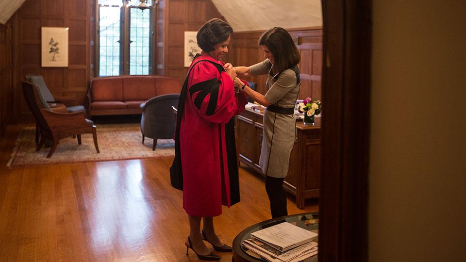 President Johnson dons her robe for the ceremony