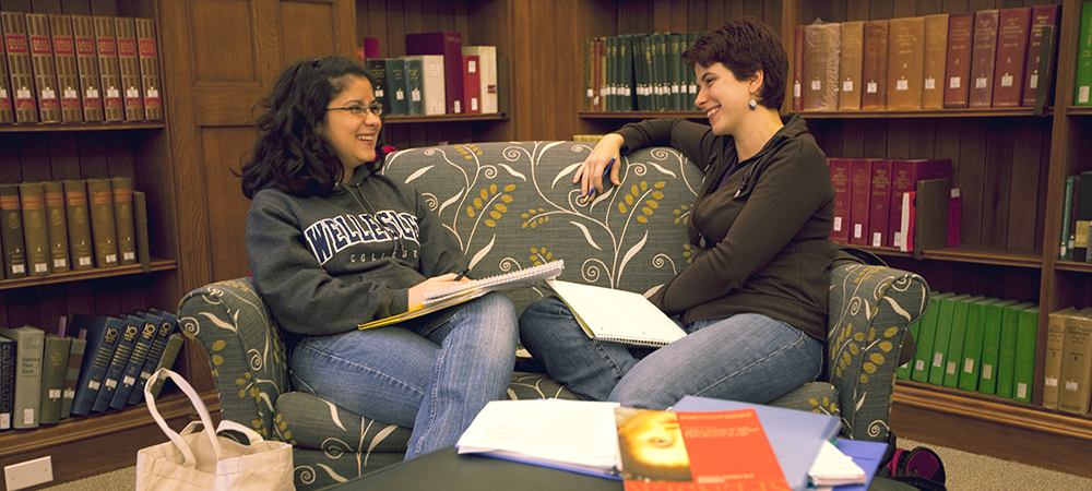 Two students chat in library
