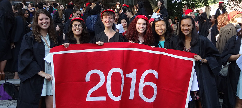 seniors and their 2016 class banner