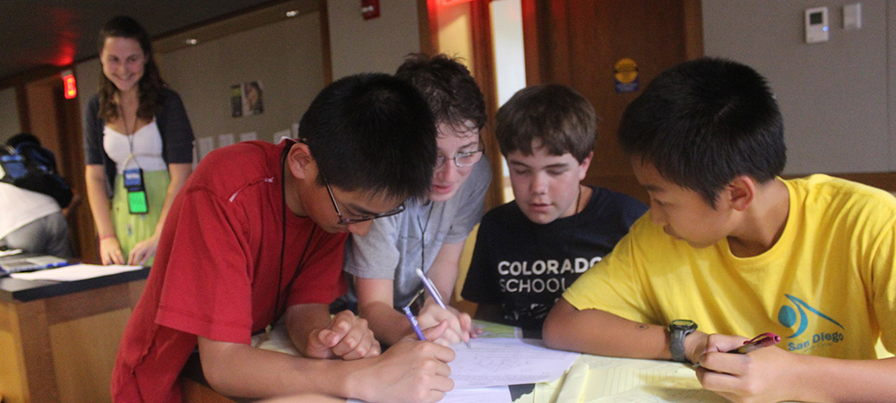 Young students work on homework together