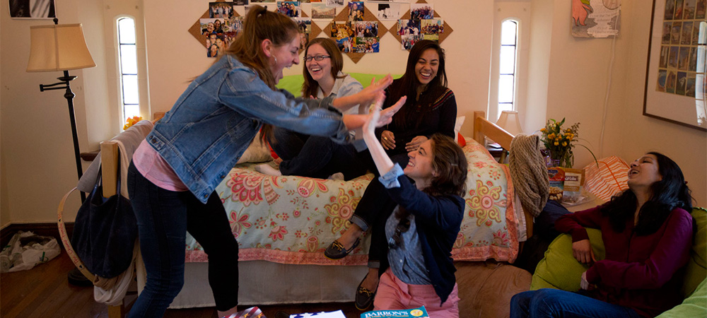 students having fun in their dorm room