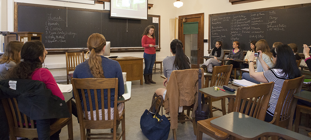 Students focus on speaker in front of class