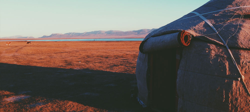 Yurt in desert at sunset