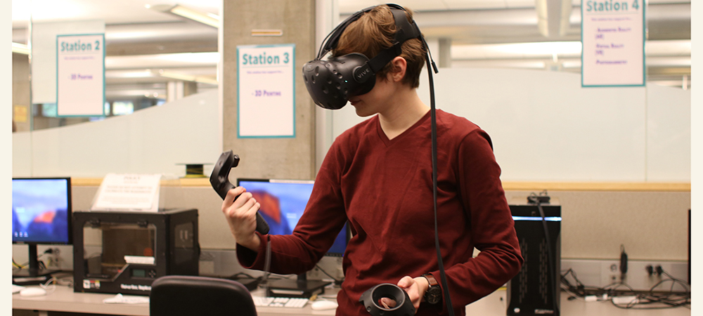 Student standing and wearing a virtual reality headset