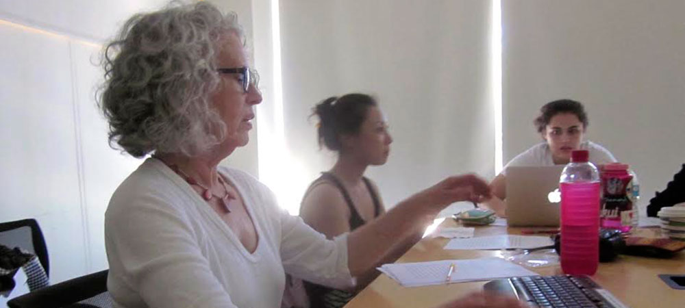 Lynne Viti gestures during class