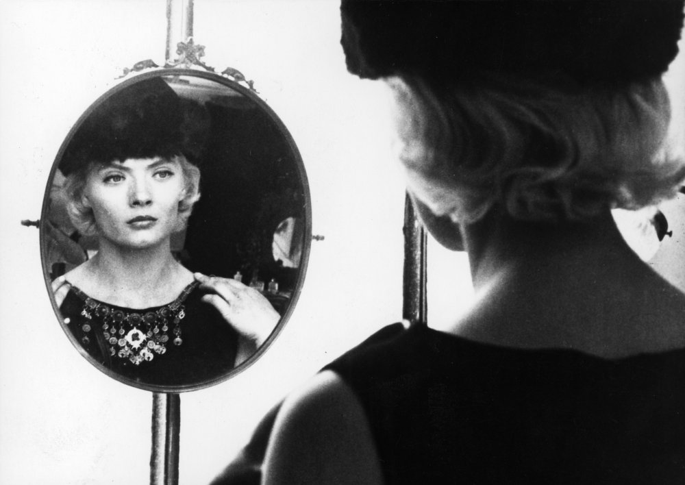 A still from the film Cleo from 5 to 7, A woman stares at herself in the mirror