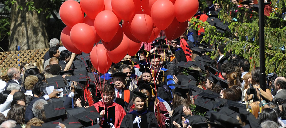 processing into the quad and red balloons