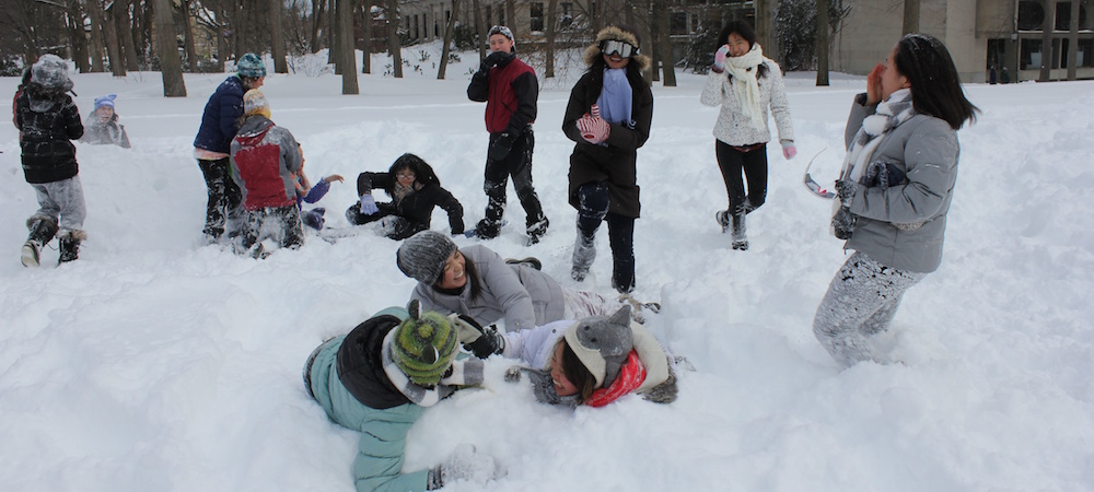 Student participate in a snow fight on Severance Green